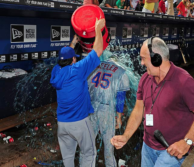 Zack Wheeler is doused by a teammate following his big league debut in the Mets 6-1 win over the Braves. Wheeler threw six scoreless innings with seven strikeouts while earning the win.