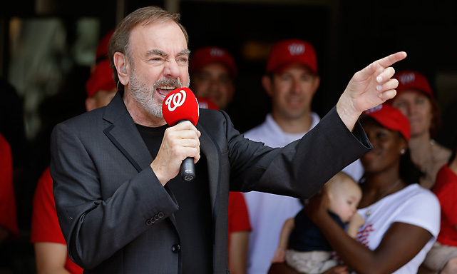 "Neil Diamond sings ""Freedom Song (They'll Never Take Us Down),"" after the third inning of a baseball game between the Nationals and Brewers."