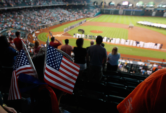 Astros' fans wave American flags before first pitch of the game against the Tampa Bay Rays.