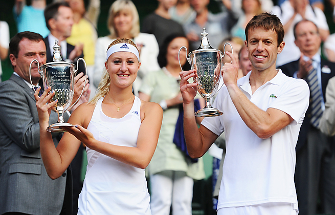 Kristina Mladenovic and Daniel Nestor upset the top-seeded Americans to win the Wimbledon mixed doubles title.