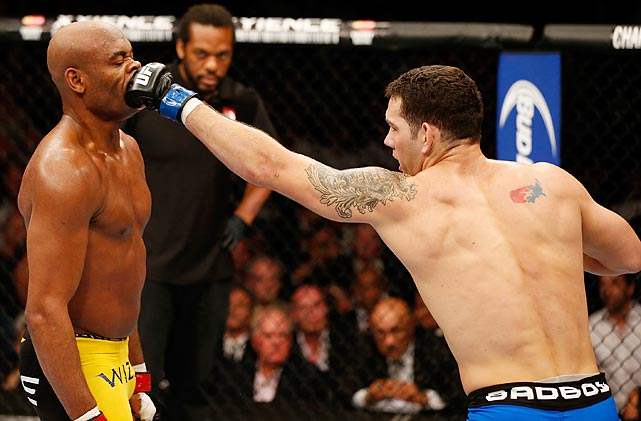 Chris Weidman (right) punches Anderson Silva in their UFC middleweight championship fight on July 6 in Las Vegas. Weidman, a heavy underdog, defeated Silva in a shocking win.