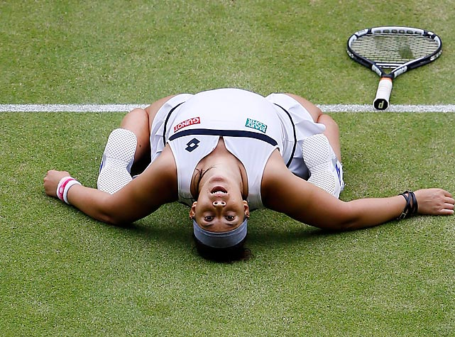 Marion Bartoli of France reacts after defeating Kirsten Flipkens of Belgium in the Wimbledon semifinals on July 4. Bartoli would win her first career major two days later when she defeated Sabine Lisicki of Germany in straight sets.