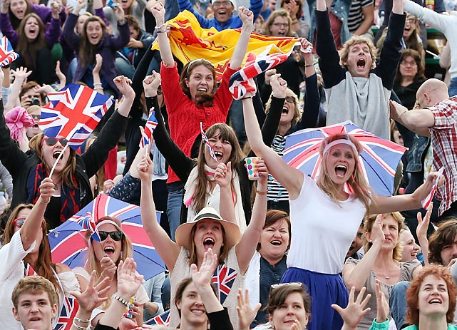 Tennis fans react after watching Great Britain's Andy Murray's fans react during his defeat of Spain's Fernando Verdasco. Murray would eventually beat Novak Djokovic in the final to become the first British man to win Wimbledon in 77 years.