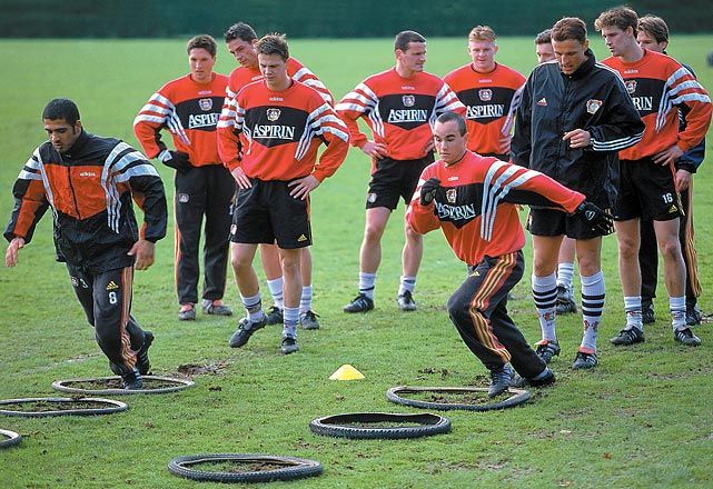 Donovan, right, runs through an agility drill at a practice session in Germany with Bayer Leverkusen.
