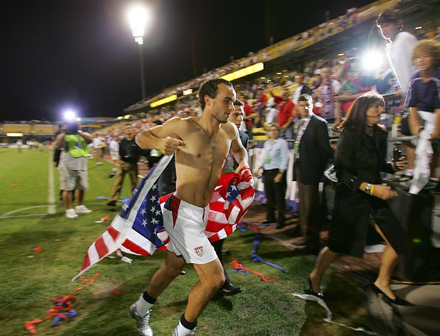 Donovan runs off the field holding an American flag after the U.S. defeated Mexico to advance to the 2006 World Cup in Germany.