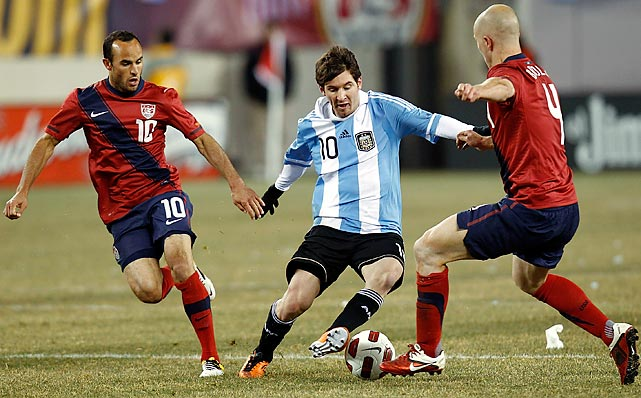 Lionel Messi of Argentina dribbles between Donovan and Michael Bradley during the first half of a friendly at Giants Stadium in East Rutherford, N.J.