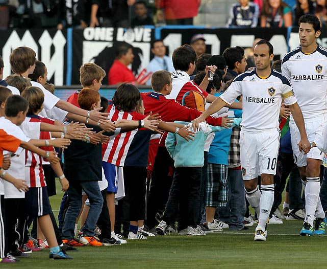 Donovan greets a line of kids as he leads the L.A. Galaxy onto the field for ceremonies before their game with Chivas USA.
