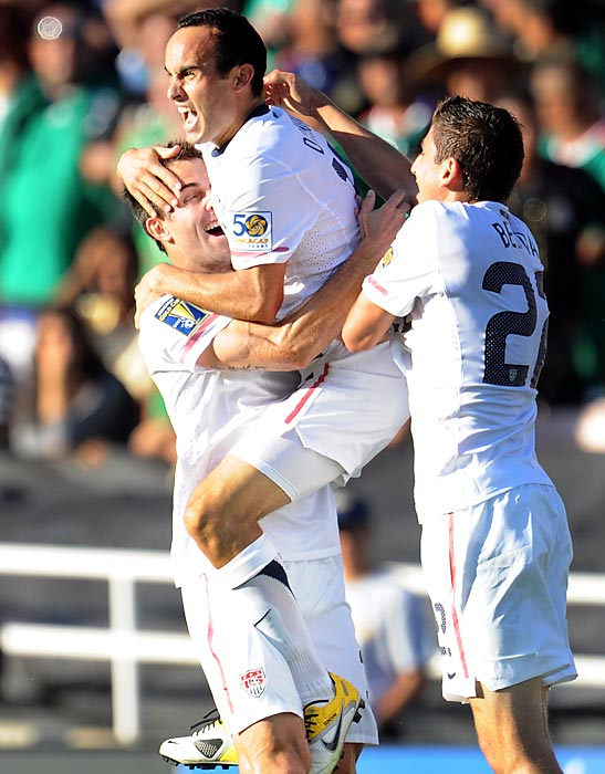 Donovan jumps into the arms of a teammate after scoring against Mexico in the first half of the CONCACAF Gold Cup final in Pasadena, Calif.