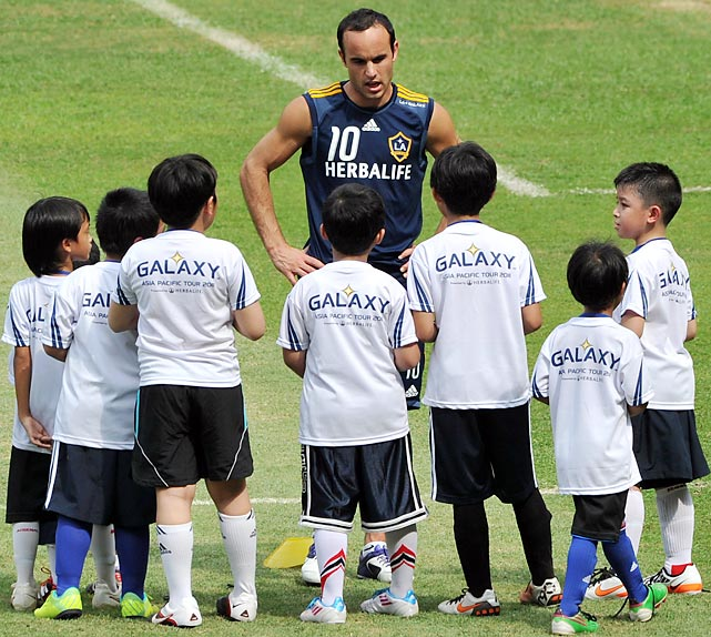 Indonesian students listen to Donovan during a soccer clinic in Jakarta. The L.A. Galaxy visited Indonesia as part of their Asia tour.