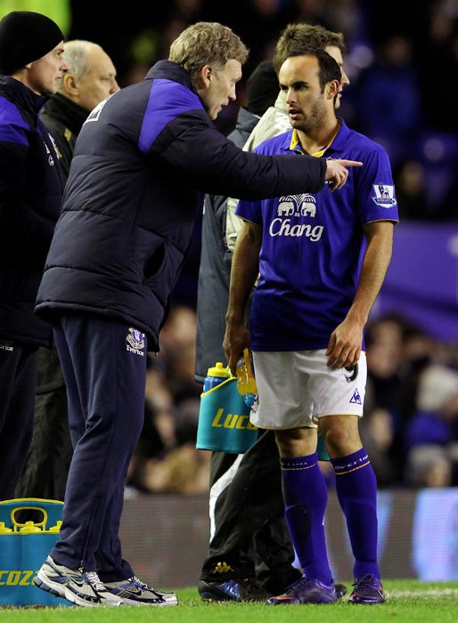 Everton Manager David Moyes gives instructions to Donovan during a FA Cup fourth-round match between Everton and Fulham at Goodison Park in Liverpool, England.