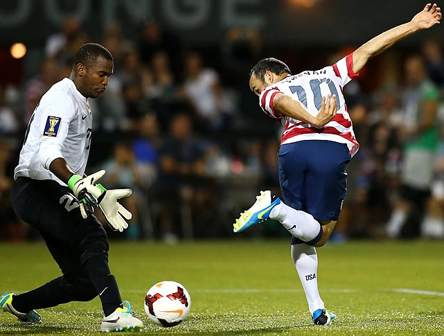 Donovan attempts a back-heeled shot against Woodrow West of Belize during the 2013 CONCACAF Gold Cup in Portland, Ore. Donovan finished with a goal and two assists -- becoming the first U.S. player to record both 50 goals and 50 assists for his career -- as the U.S. won easily, 6-1.