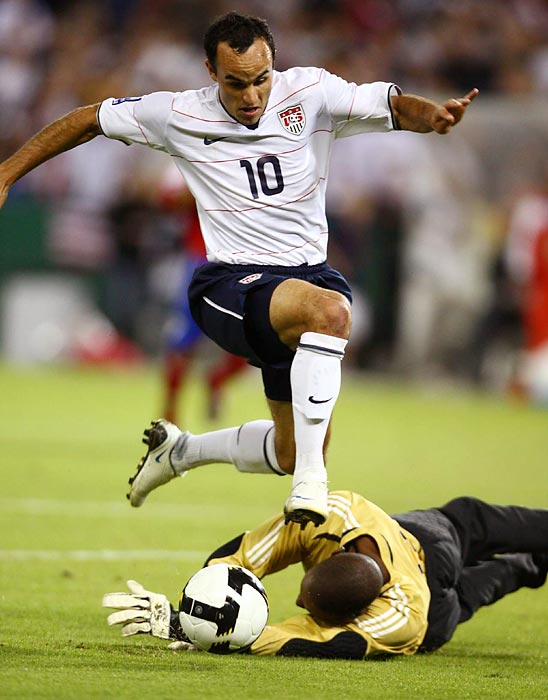 Donovan clashes with the goalkeeper during a U.S. match with Cuba.