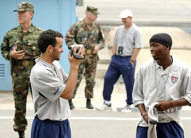 Donovan records teammate DaMarcus Beasley during the national team's visit to the demilitarized zone.