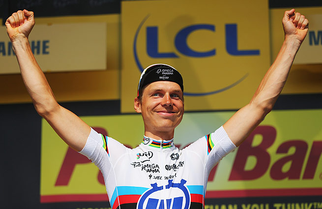 Germany's Tony Martin captured the 11th stage of the Tour de France, finishing ahead of overall leader Chris Froome.