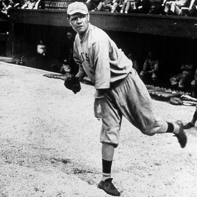 Rookie pitcher Babe Ruth warms up before a game. Ruth began his career as a successful starting pitcher for the Boston Red Sox.