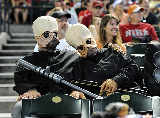 Star Wars characters take in a game between the Arizona Diamondbacks and the Cincinnati Reds at Chase Field in Phoenix.