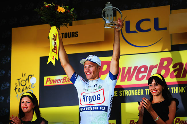 Germany's Marcel Kittel passed Mark Cavendish at the line to win the 12th stage of the Tour de France.