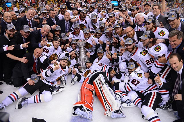 The Chicago Blackhawks defeated the Boston Bruins, clinching the series with two goals in last 90 seconds of Game 6. The series included a Game 1 triple-overtime game -- only the eighth in Stanley Cup history.