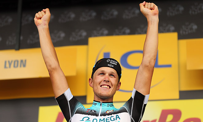 Matteo Trentin win the 14th stage of teh Tour de France by half a wheel length in a sprint finish.