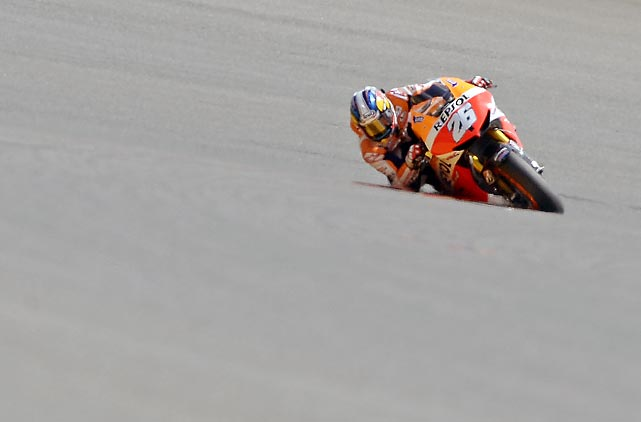Dani Pedrosa of Spain banks into a turn during a practice run in preparation for the Motorcycle Grand Prix of Germany, which began on Sunday, July 14.