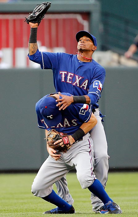 Engel Beltre of the Texas Rangers (rear) avoids a collision with teammate Ian Kinsler (front) while catching a fly-out against the Baltimore Orioles on July 8 in Baltimore.