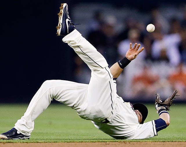 San Diego Padres shortstop Everth Cabrera fumbles the ball as he tries to get the San Francisco Giants' Gregor Blanco out at first in the third inning of a baseball game at Petco Park in San Diego on July 12.
