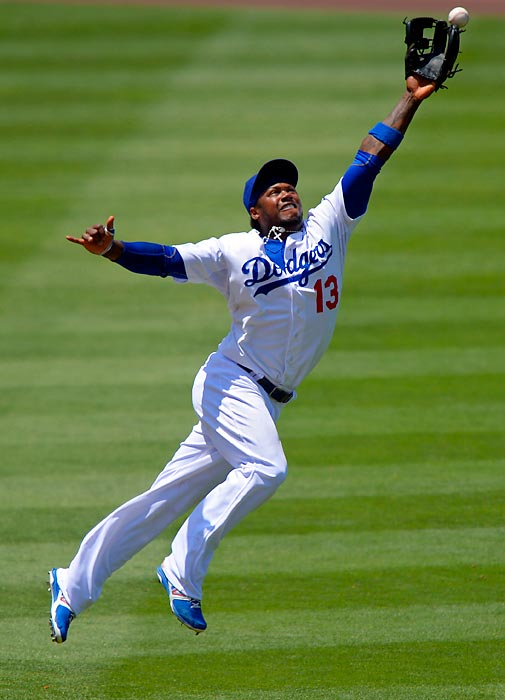 Los Angeles Dodgers shortstop Hanley Ramirez fails to reach a soaring liner hit by the Colorado Rockies' Todd Helton on Sunday, July 14, in Los Angeles.