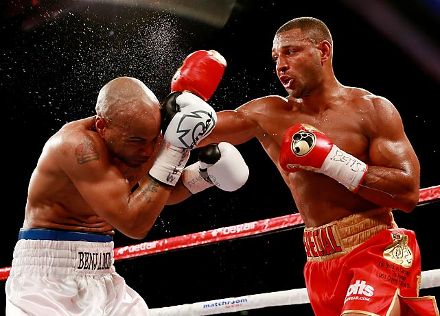 Kell Brook of England lands a right-handed punch on Carson Jones of the United States during their welterweight fight in Hull, England, on July 13.