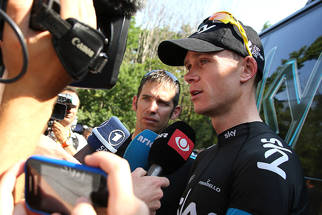 Chris Froome is peppered with questions from journalists on a Tour de France off day.