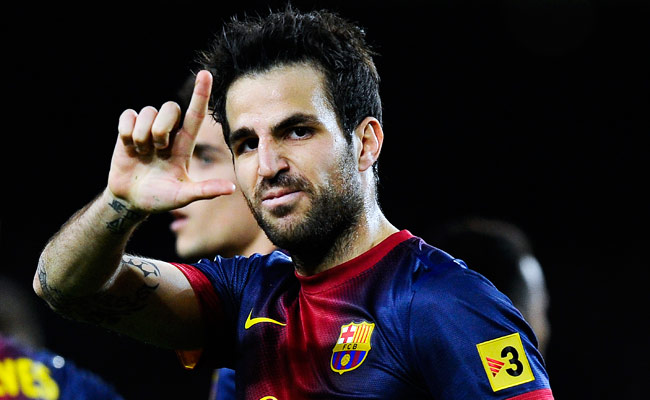 Cesc Fabregas celebrates after scoring a goal for Barcelona against RCD Mallorca in April.
