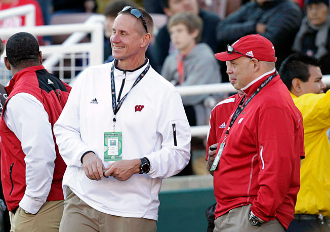 Northern Illinois has hired Wisconsin deputy athletic director Sean Frazier (right) to become its new AD.