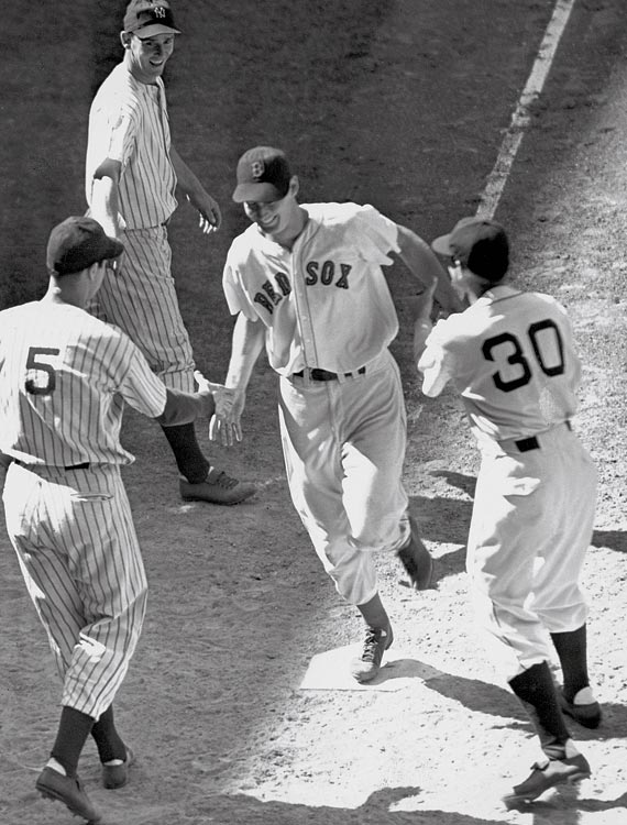 Joe DiMaggio (5) was on base when Ted Williams hit a two-out, three-run homer in the bottom of the ninth to lift the AL to a 7-5 victory in the midsummer classic in Detroit's old Briggs Stadium.
