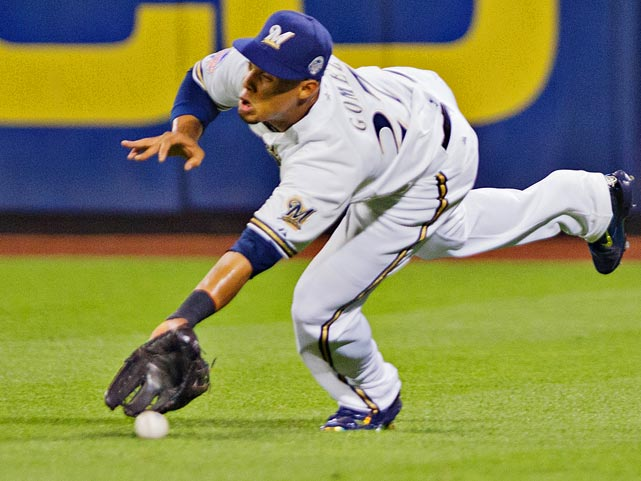 Carlos Gonzalez of the Colorado Rockies fails to make a play on this ball hit by Prince Fielder.