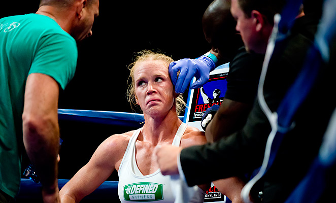 Holly Holm is being retrained to fight MMA by Mike Winklejohn (left).