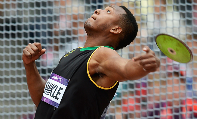 Jamaica's Traves Smikle hurls a discus during qualifications at the London 2012 Olympic Games.