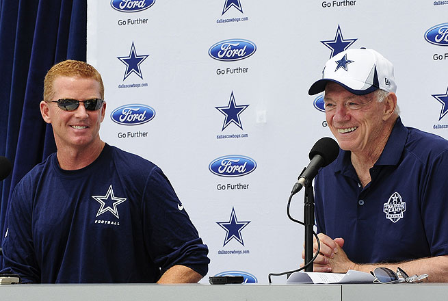 Dallas coach Jason Garrett (left) received a vote of confidence from owner Jerry Jones.