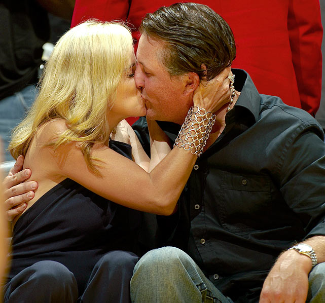 Phil and Amy kiss while in attendance for Game 5 of the Western Conference semifinals between the Rockets and Lakers in Los Angeles.
