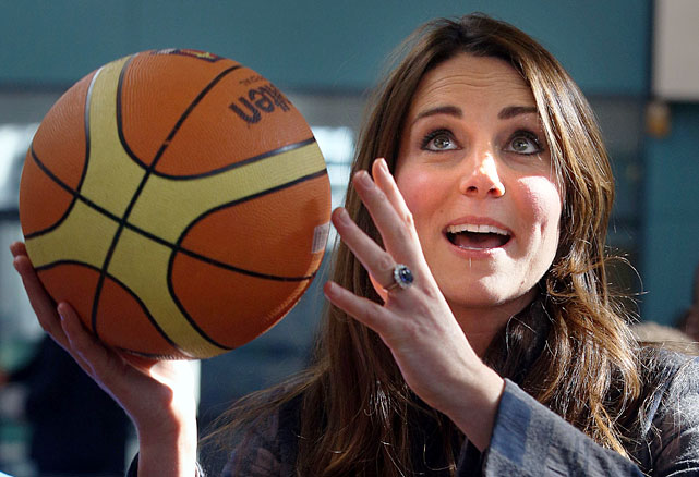 Kate Middleton plays a little basketball during a visit with Prince William to the Donald Dewar Leisure Centre to launch a new project for their foundation.