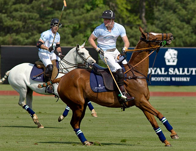 Prince Harry turns to the ball during the Sentebale Royal Salute Polo Cup charity match in Greenwich, Conn.