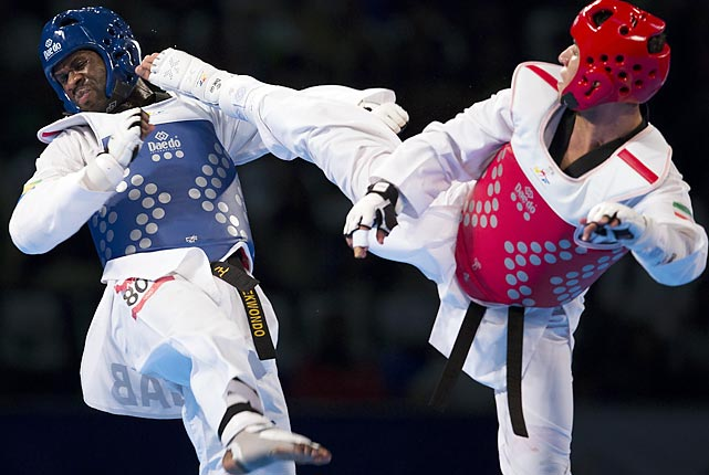 Anthony Obame of Gabon competes with Iran's Sajjad Mardani during the men's +87kg final of the WTF World Taekwondo Championships in Puebla, Mexico.