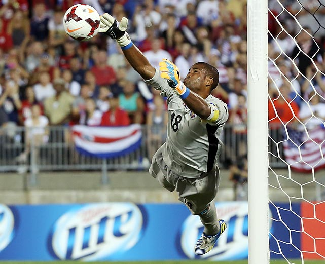Costa Rica goalkeeper Patrick Pemberton dives to parry away a free kick during a 2013 CONCACAF Gold Cup match vs. the United States. The US won 1-0.