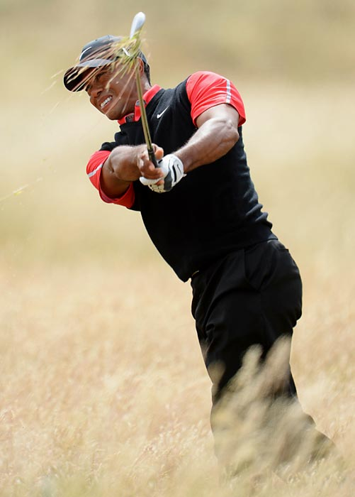Tiger Woods plays out of the rough on the 5th hole during the final round of the 142nd Open Championship at Muirfield. Woods shot a final round 74 and finished tied for sixth place at two-over par.