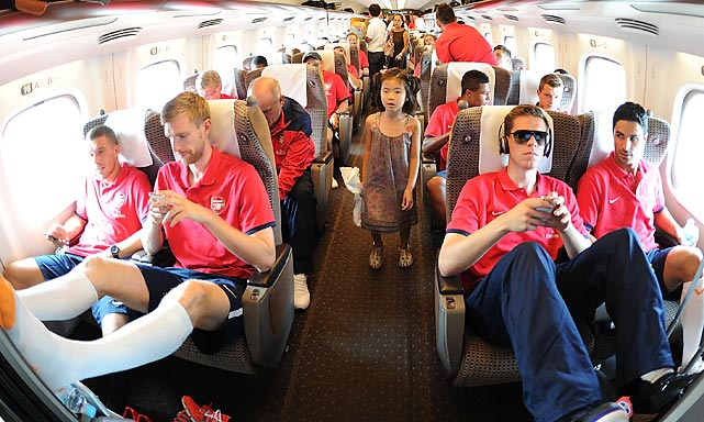 It's only fitting that a soccer team named Arsenal would be found on a bullet train, this one from Nagoya to Saitama, Japan, during the club's preseason Asian tour.
