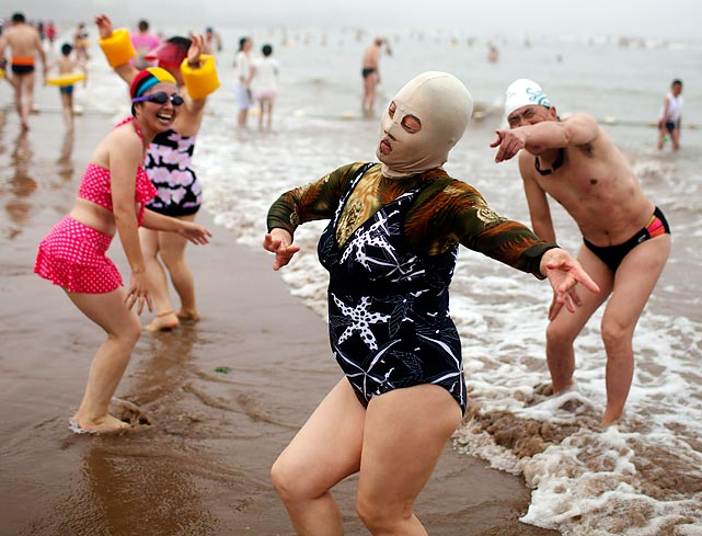 In a sneak preview of the next SI Swimsuit issue, one of our lovely models casually displays the latest in fashionable protective headgear in the exotic locale of Qingdao, China. Perfect for warding off sunburn and jellyfish, this stylish nylon mask is never out of place during piracy on the high seas or a bank heist.