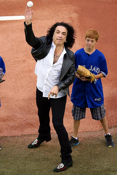 The KISS axeman delivered the ceremonial first pitch before the Blue Jays took on the Dodgers at Rogers Centre in Toronto. No makeup game was scheduled. (For an explanation of that so-called gag, CLICK HERE.)