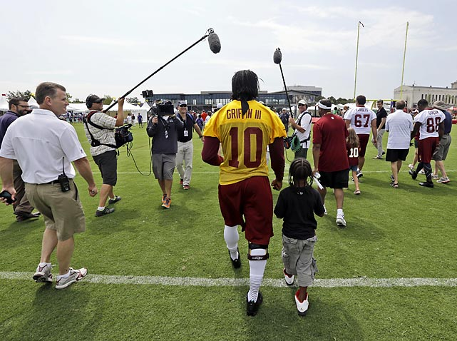 Griffin III walks off the field with fan Michael Dabney, 7, of Richmond.