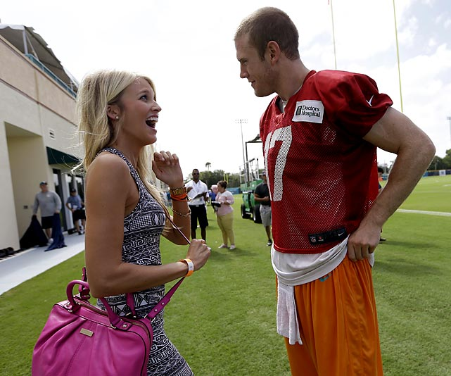 Ryan Tannehill talks with his wife, Lauren, after a Dolphins practice.