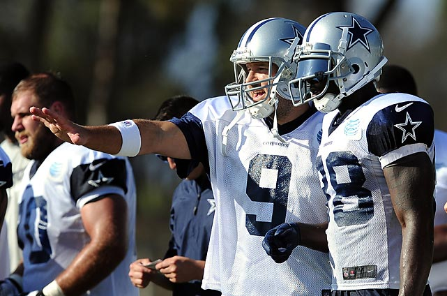 Dallas Cowboys quarterback Tony Romo (9) and wide receiver Dez Bryant discuss a play