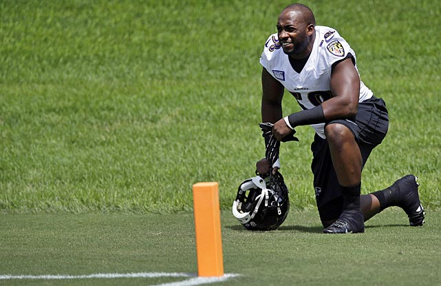 New Ravens linebacker Elvis Dumervil pauses before joining teammates for training camp at the team's practice facility in Owings Mills, Md.