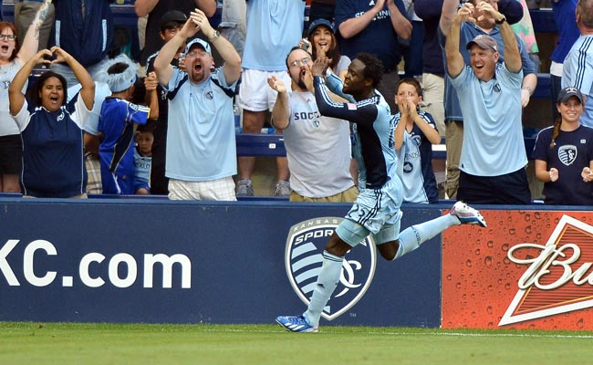 Kei Kamara holds up a heart shape to the Sporting K.C. fans after scoring vs. Columbus in June.